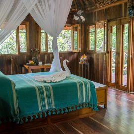 Bed inside a treehouse, Zapote.