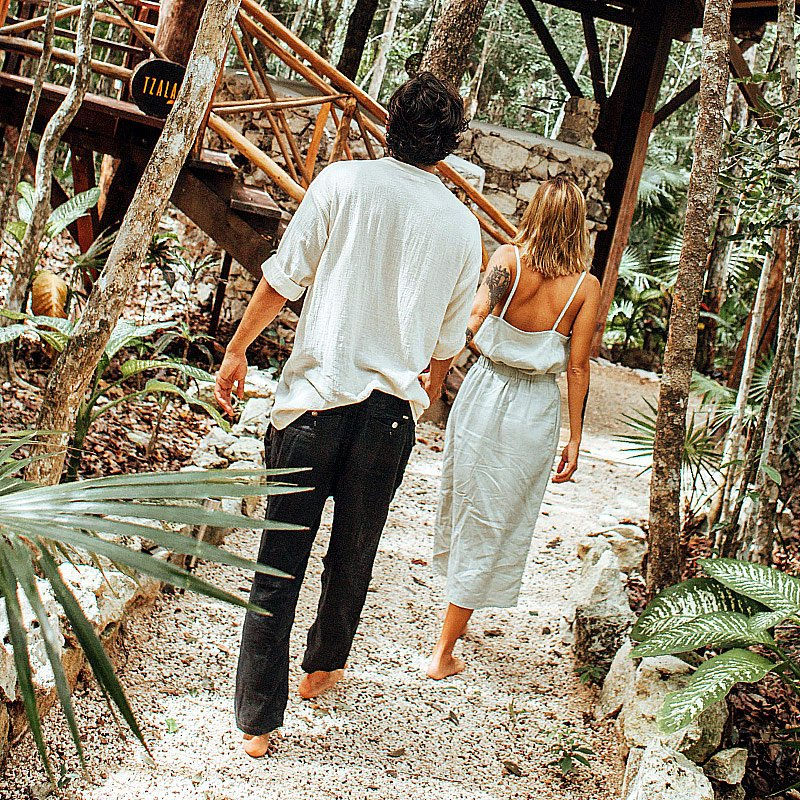 Couple walking towards a Tree House wood stair.